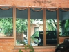 fixed-with-casment-window-fitted-with-reflecative-glass-in-bronze-anodize