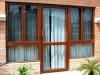 hinge-door-with-casement-window-in-brown-powder-coated
